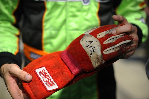 James Hinchcliffe with Greg Moore\'s gloves 2012